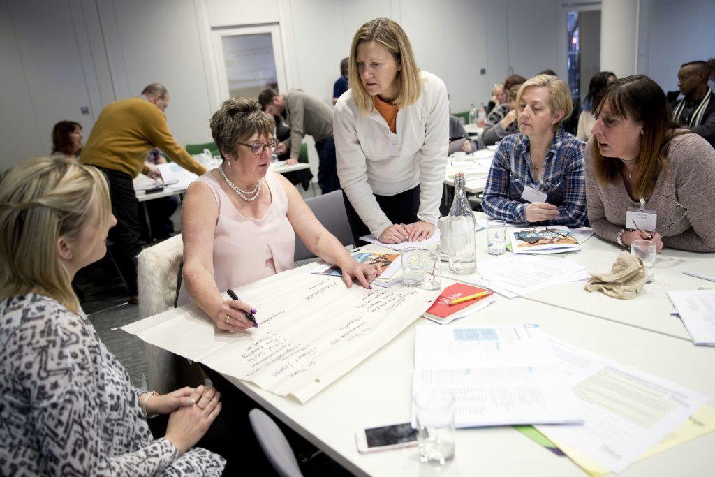 Workshop participants writing © Jess Hurd/reportdigital.co.uk